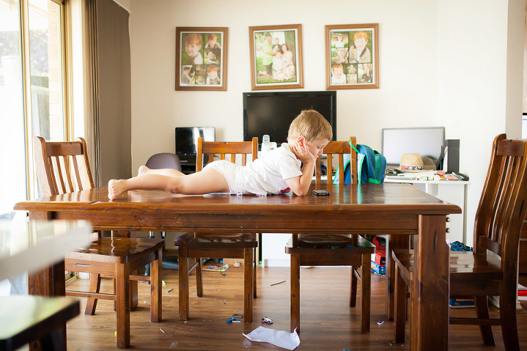 Little boy lying on table - family documentary Photography