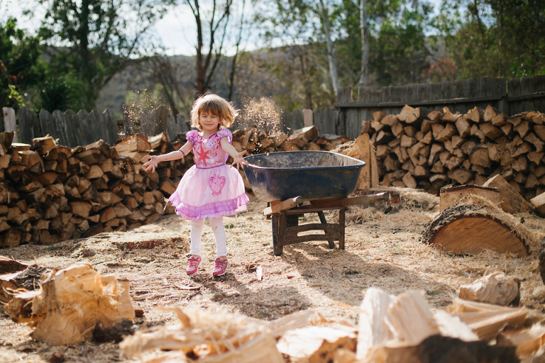 little girl in princess dress plays in dirt - family documentary photography