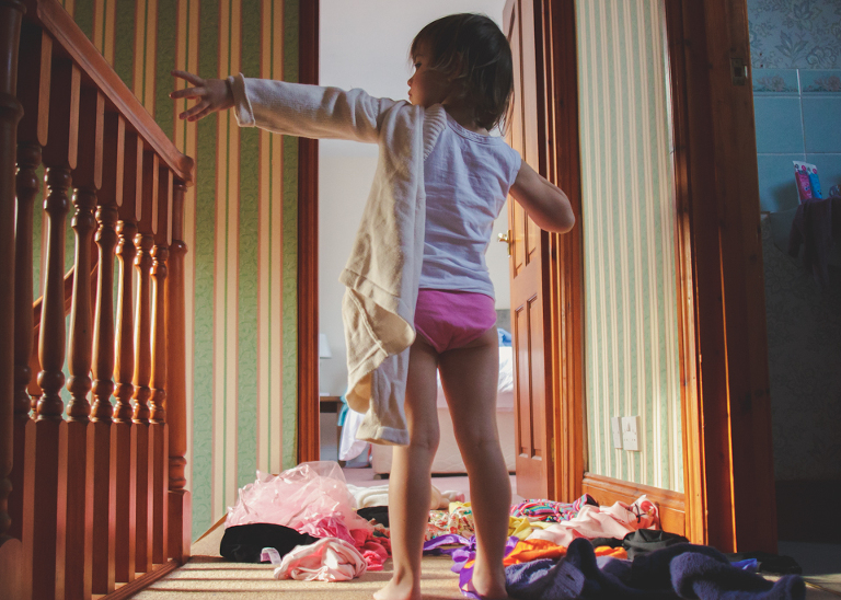 little girl plays dress up - family documentary photography