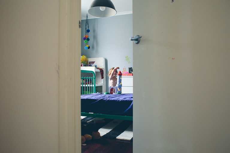 child playing alone in bedroom - family documentary photography