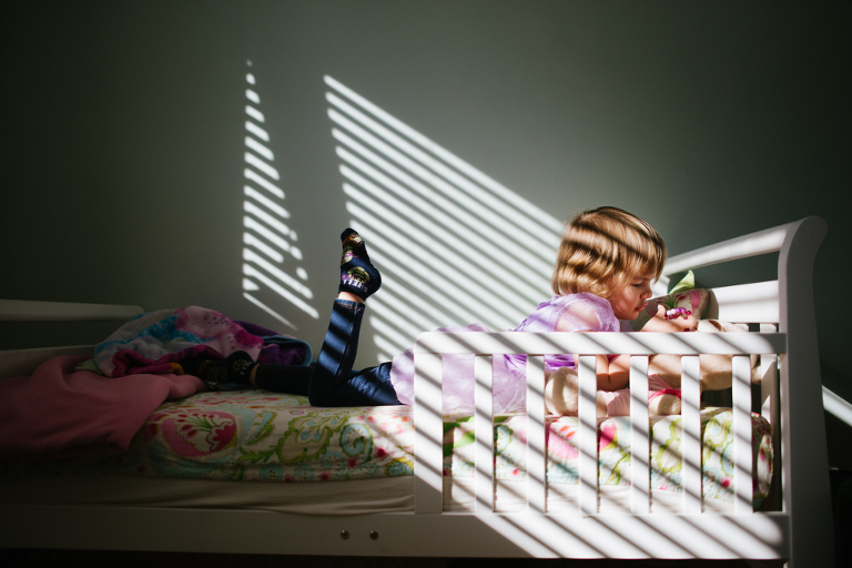 girl on bed in sunny spot - Family Documentary Photography