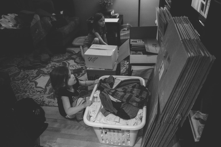 girls packing in black and white - Family Documentary Photography