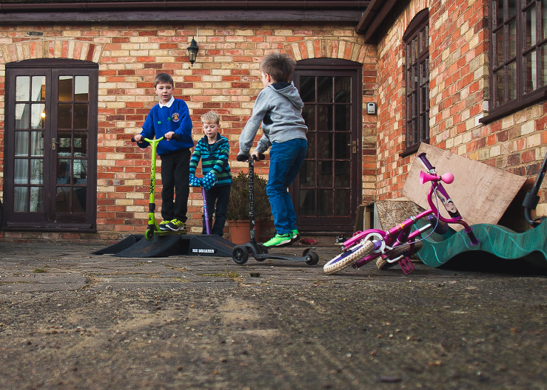 Boys on scooters - Family Documentary Photography