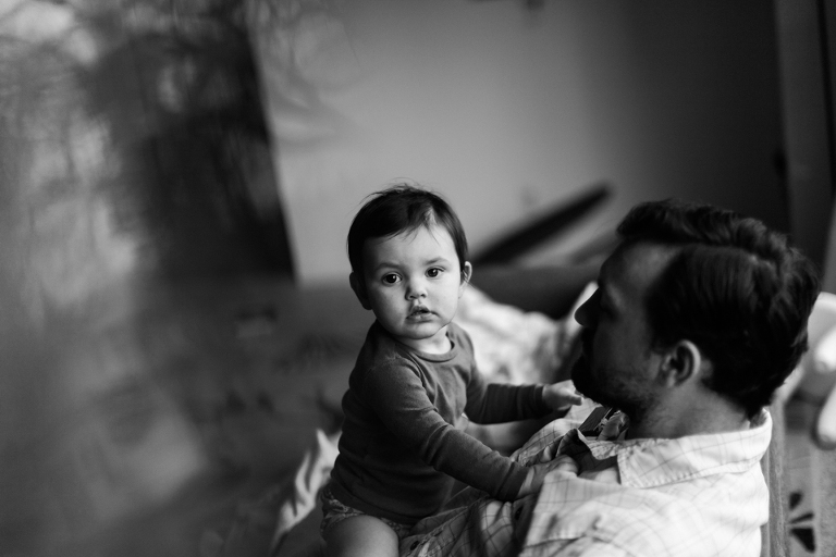 baby girl in father's lap black and white - Family Documentary Photography