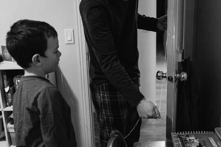 pulling a tooth by doorknob - Family Documentary Photography