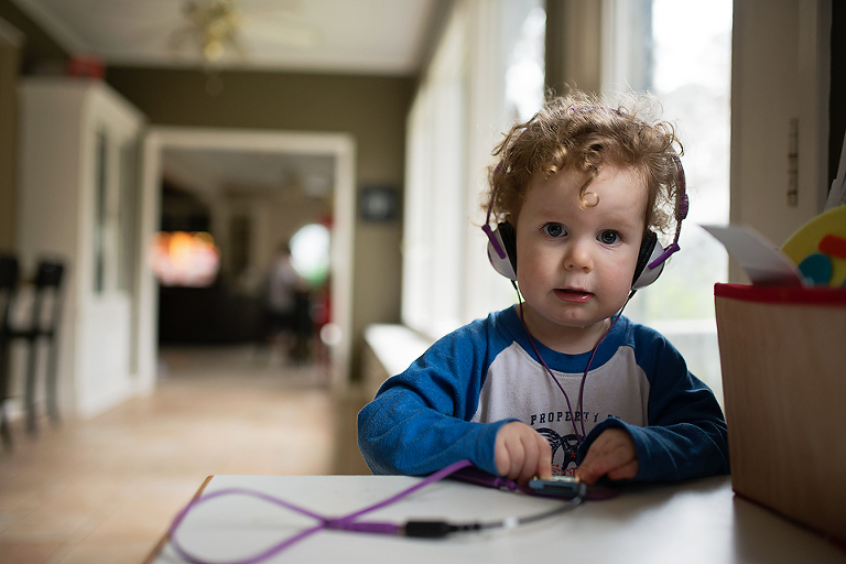Baby with headphones - Family Documentary Photography