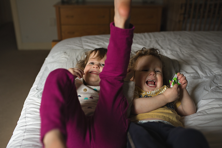 kids laughing in bed - Family Documentary Photography