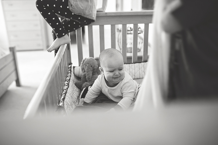 Baby in crib - Family Documentary Photography