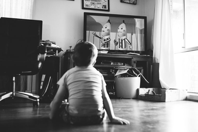 Child watching TV - Family Documentary Photography