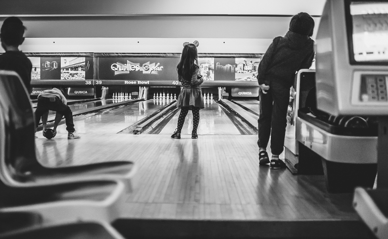 girl at bowling alley - Family Documentary Photography