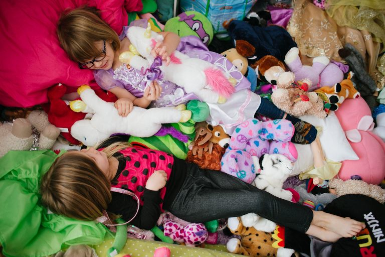 kids in pile of stuffed animals - Family Documentary Photography