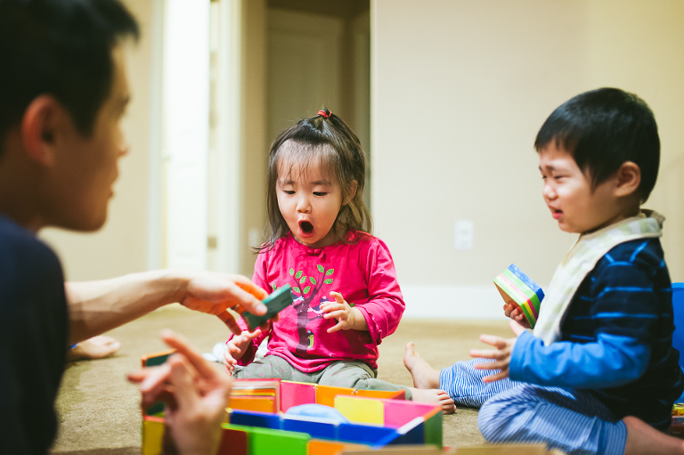 Little Girl is surprised while playing with blocks - Perfectly Real Artist