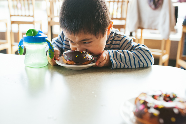 Boy eats donut - Perfectly Real Artist