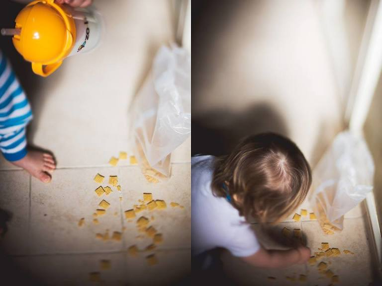 picking up spilled cereal - Family Documentary Photography
