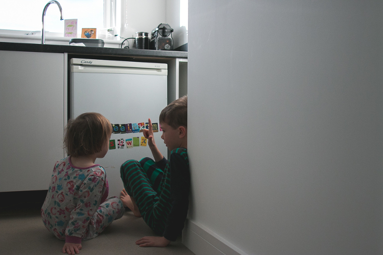 Kids at dishwasher - Family Documentary Photography