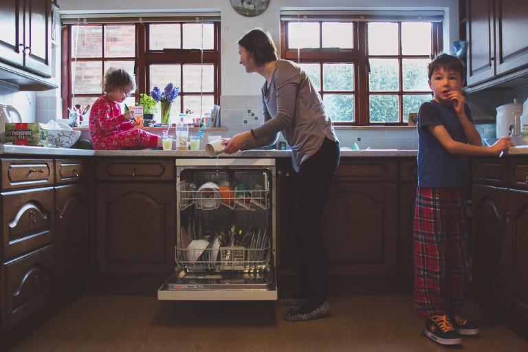 family loading dishwasher - family documentary photography