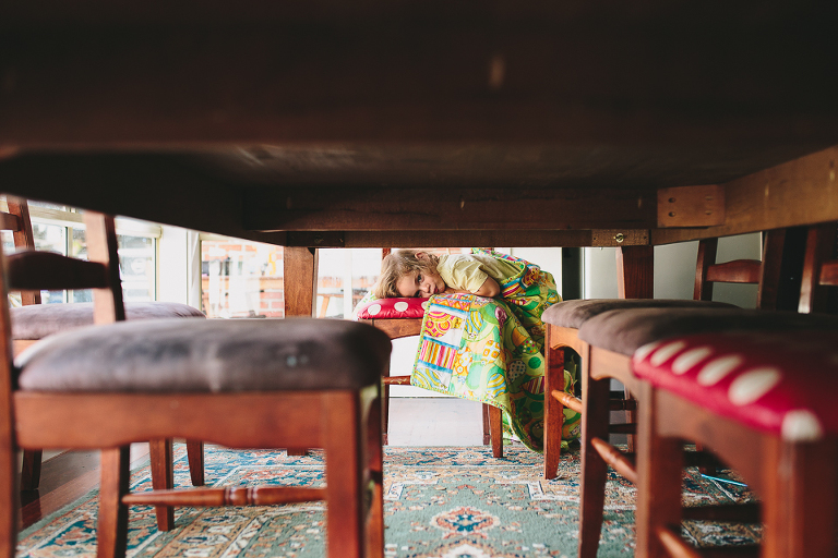 view of boy from under table - Family Documentary Photography