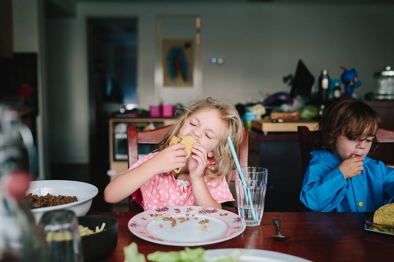 little girl eats taco - family documentary photography