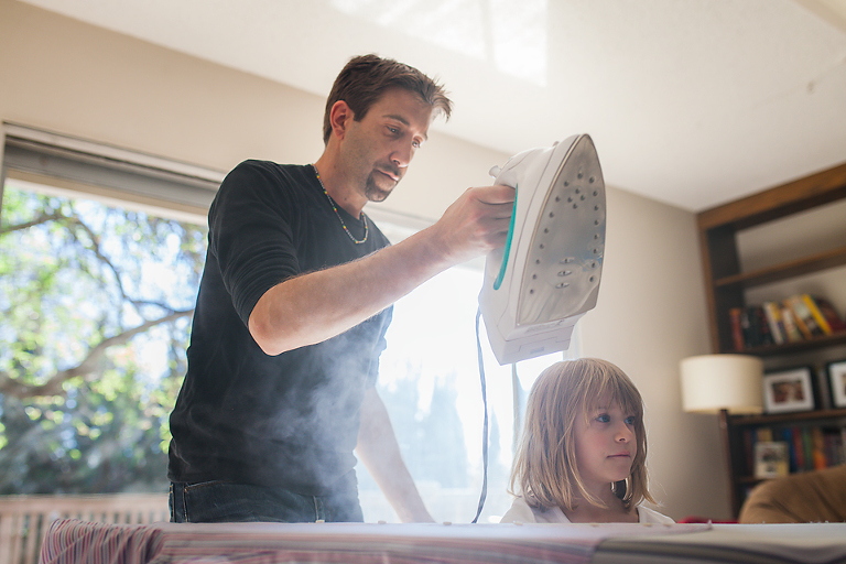 Helping dad Iron - family documentary photography