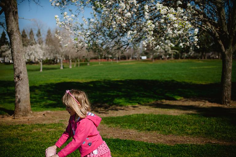 girl pushes stroller in park - Family Documentary Photography