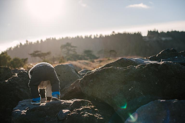 little boy climbs rocks - family documentary photography