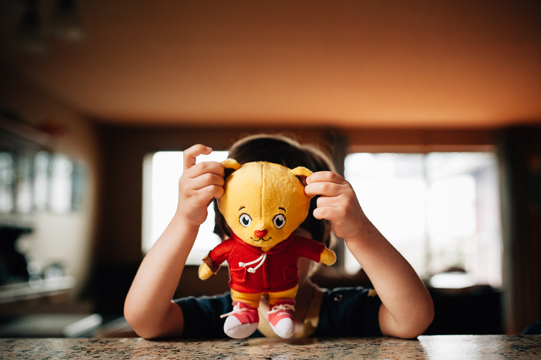Little boy with Daniel Tiger toy - Family Documentary Photography