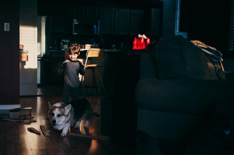 boy chases dog - Family Documentary Photography