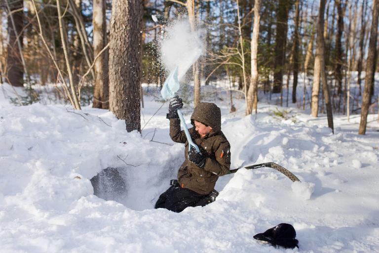 boy shovels snow - Family Documentary Photography