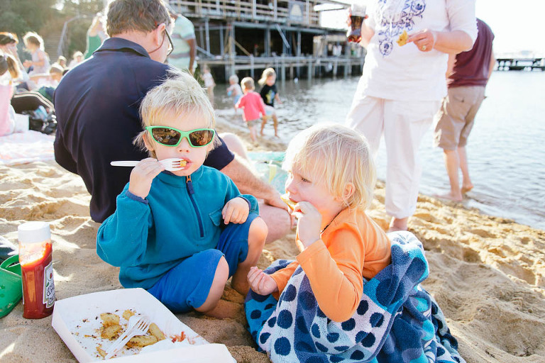 kids eating at beach - Family Documentary Photography