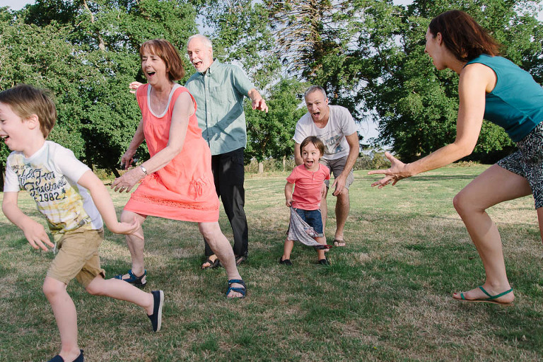 Family playing tag - Family Documentary Photography Interview