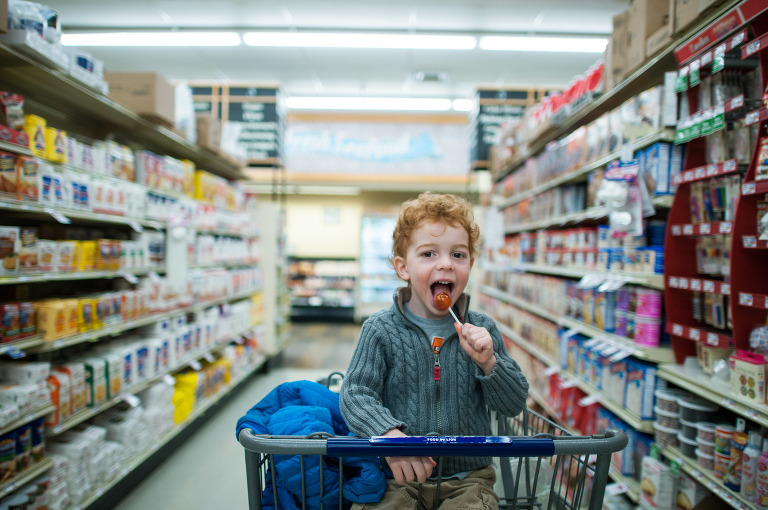 boy in shopping cart - Family Documentary Photography Interview