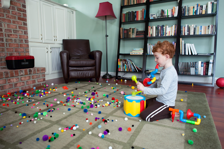 a boy, toy drums and pom poms - family documentary photography