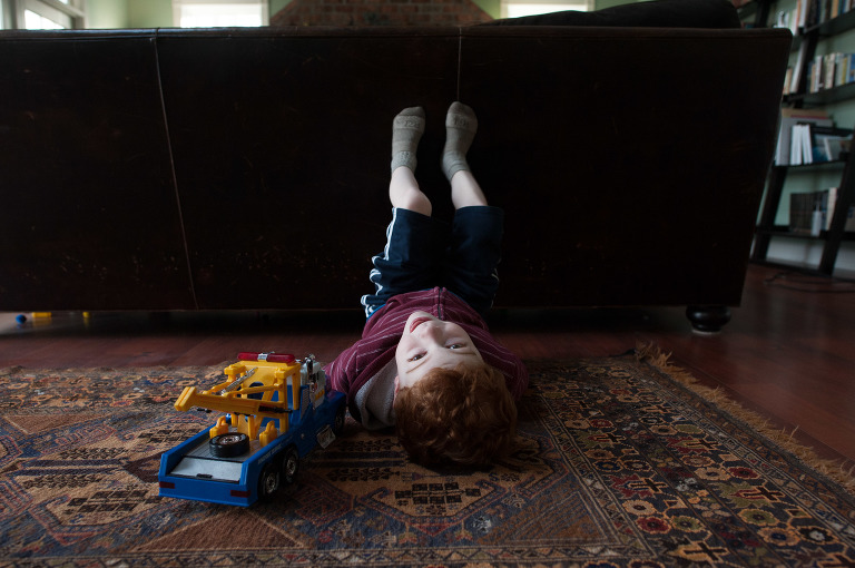 boy lounging on floor - Family Documentary Photography