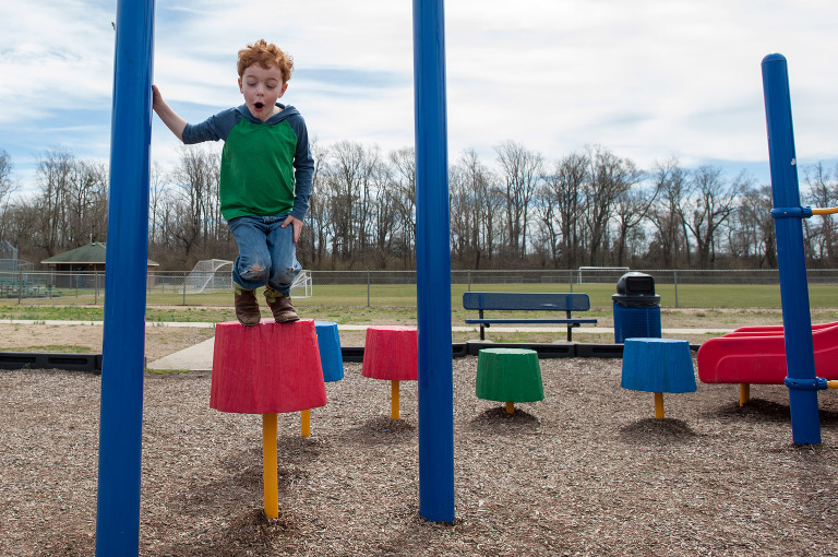 little boy on playground - Family Documentary Photography