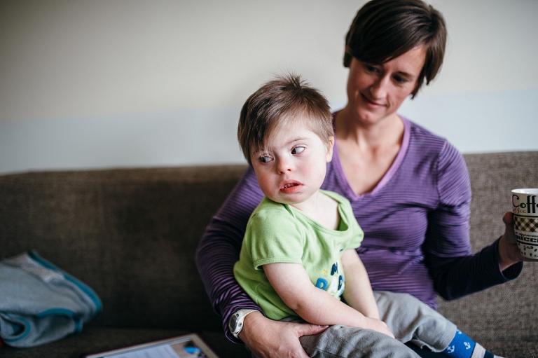 boy on mom's lap - Family Documentary Photography