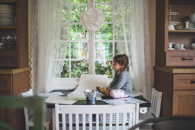 Girl on dinner table - Family Documentary Photography