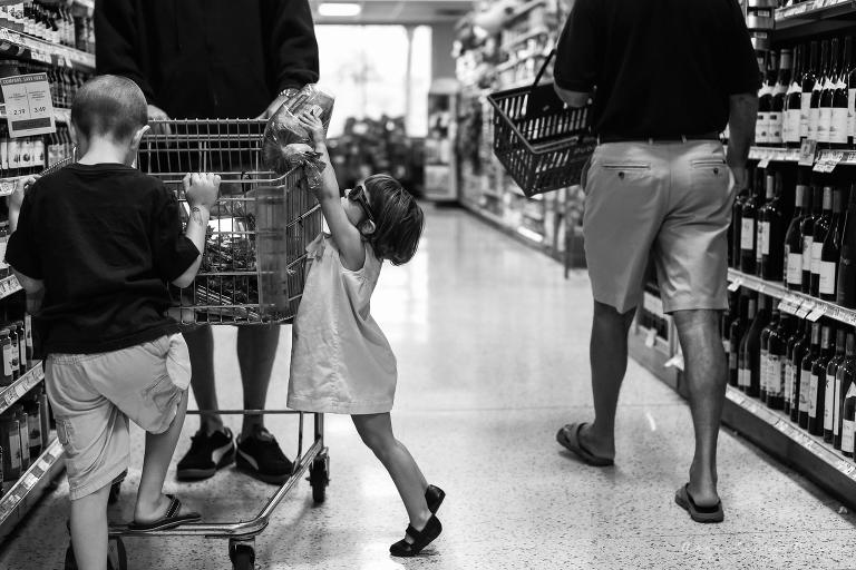 Girl with sunglasses at shopping cart - at the store, Family Documentary Photography