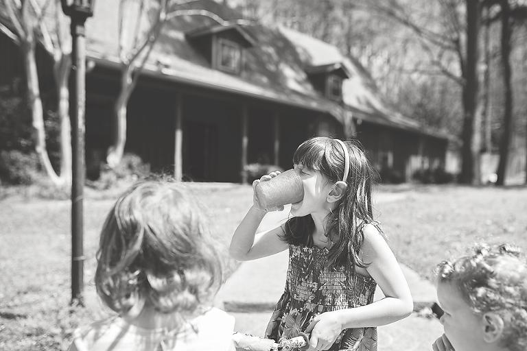 girl drinking lemonade outside - Family Documentary Photography