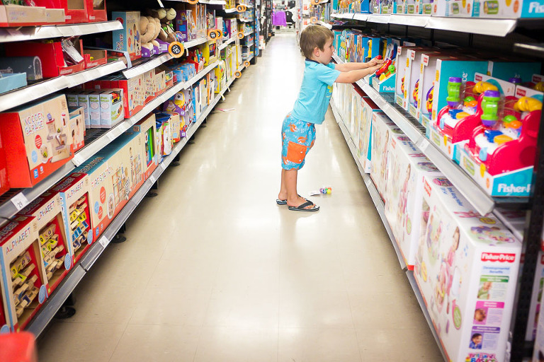 Boy at store in aisle - Family Documentary Photography