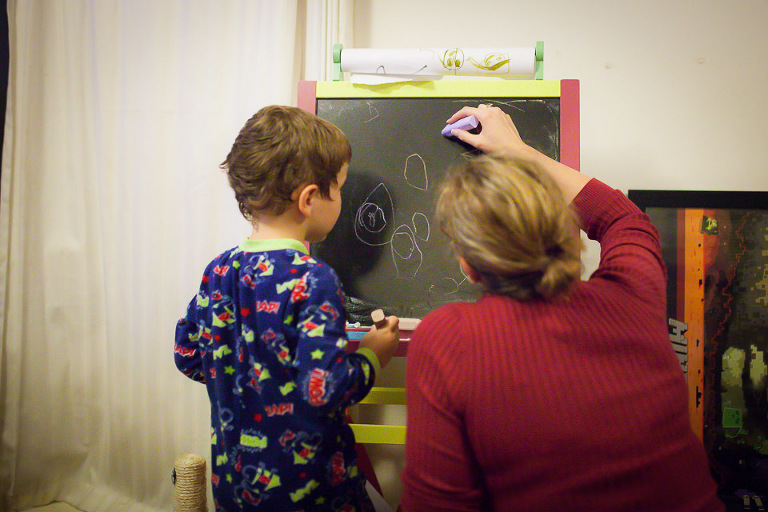 Boy with mom at Chalkboard - Family Documentary Photography