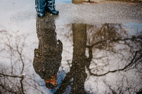 kid's reflection in puddle - Family Documentary Photography