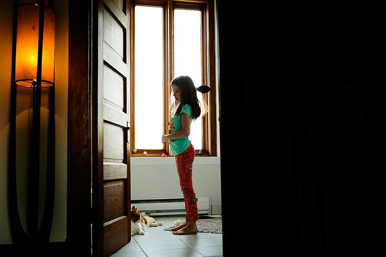 girl in swimsuit in doorway - Family Documentary Photography