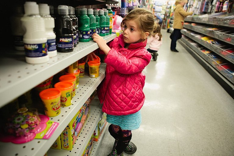Girl in shopping asile - At the Store, Family Documentary Photography