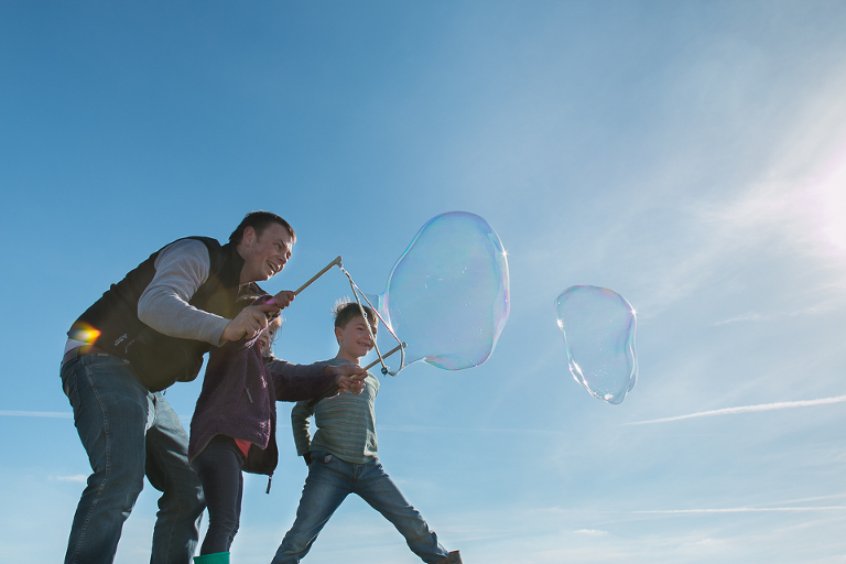 family blowing bubbles - Family Documentary Photography