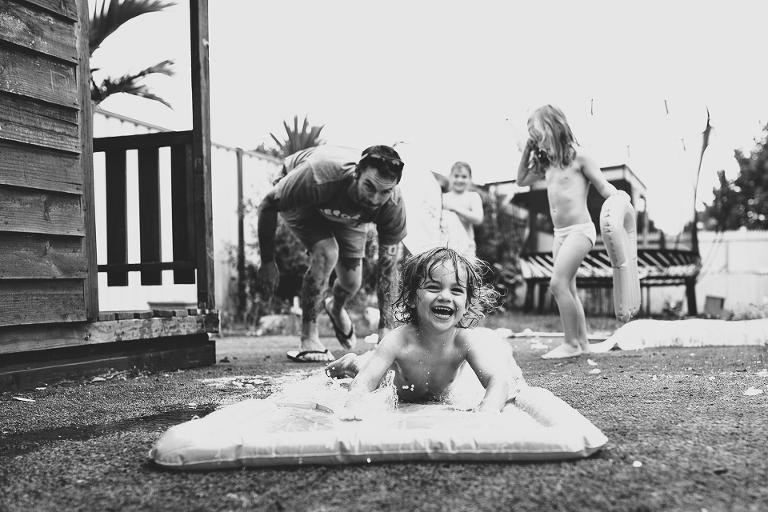 child on slip & slide - Family Documentary Photography