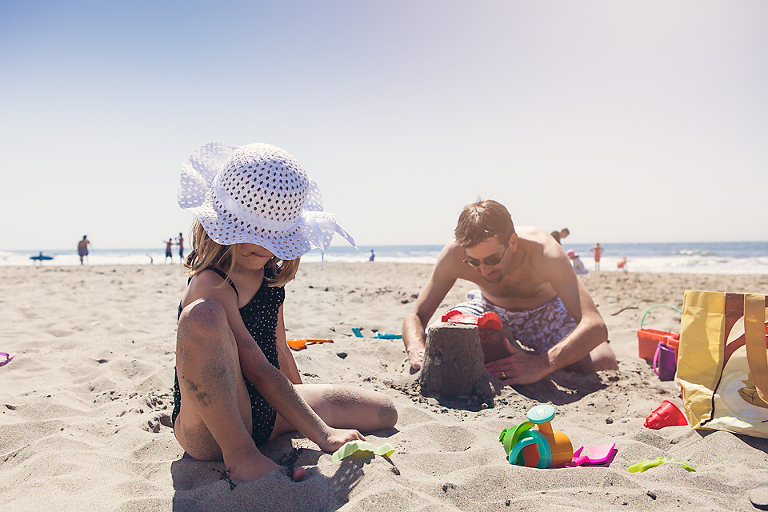 girl in hat at beach - Family Documentary Photography