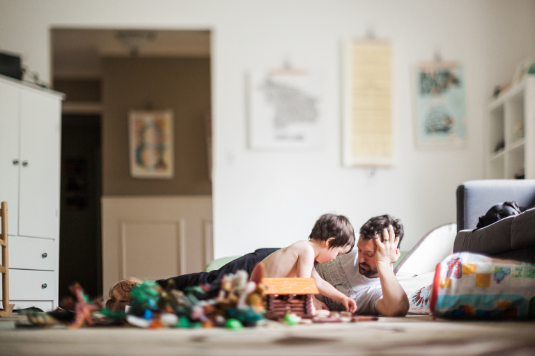 boy plays with dad on the floor - Family Documentary Photography