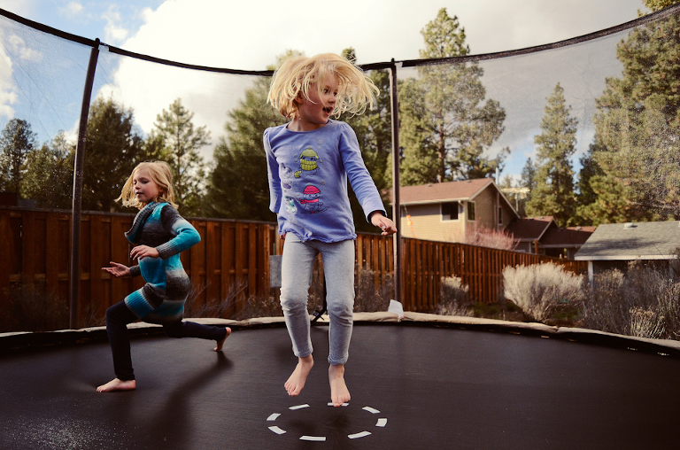 girls on trampoline - Perfectly Real Artist - Phillip Wise - Family Documentary Photography