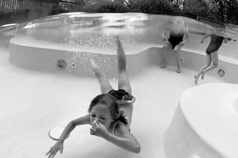 Girl swimming in pool - Perfectly Real Artist - Phillip Wise - Family Documentary Photography