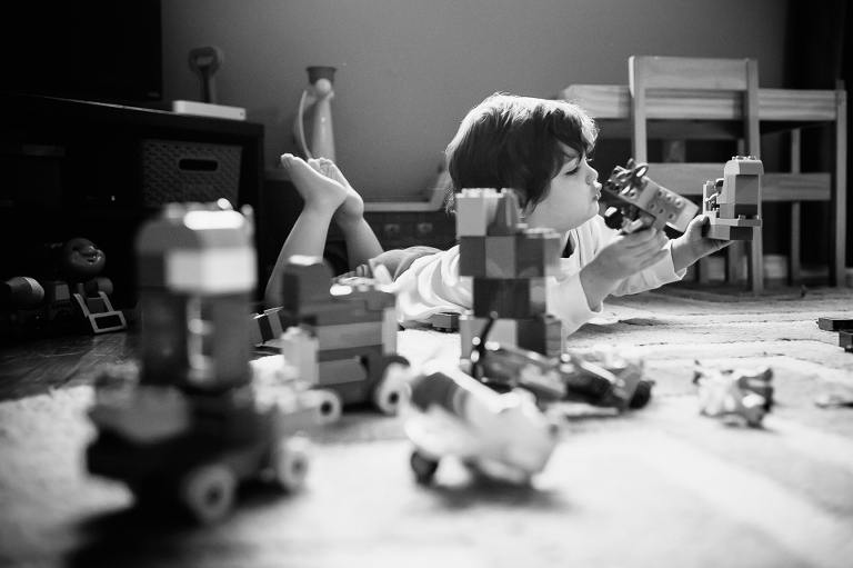 little boy plays with legos - Family Documentary Photography